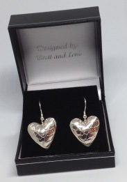Drop heart silver earrings £25