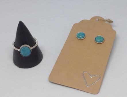 Silver ring £26, silver stud earrings £16
